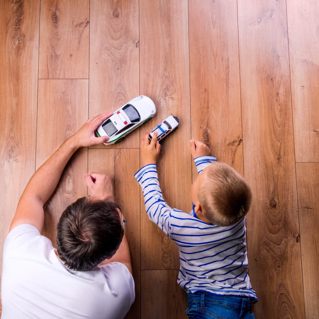 Father and kid playing with toycar | Bassett Carpets