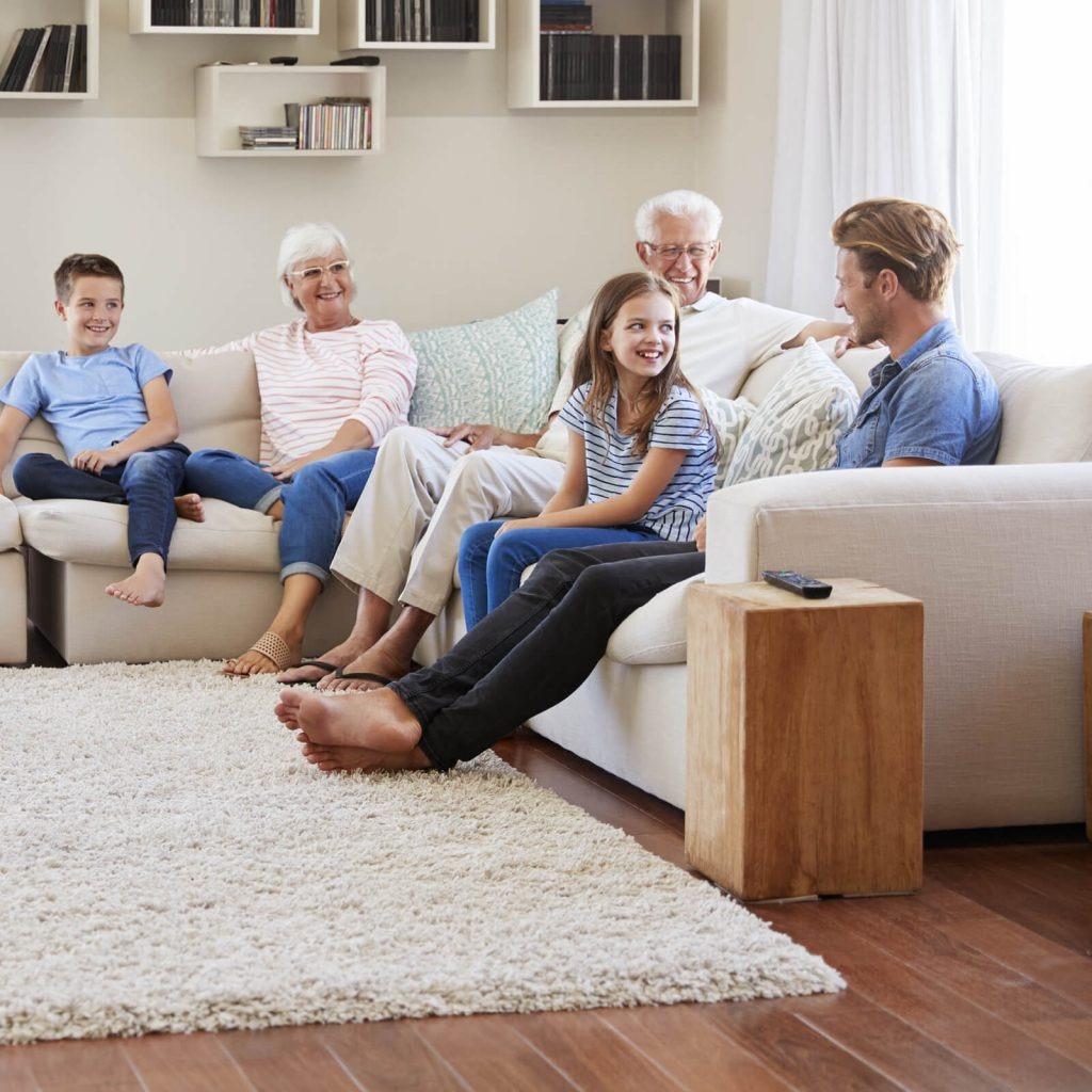 Family gosping in living room | Bassett Carpets
