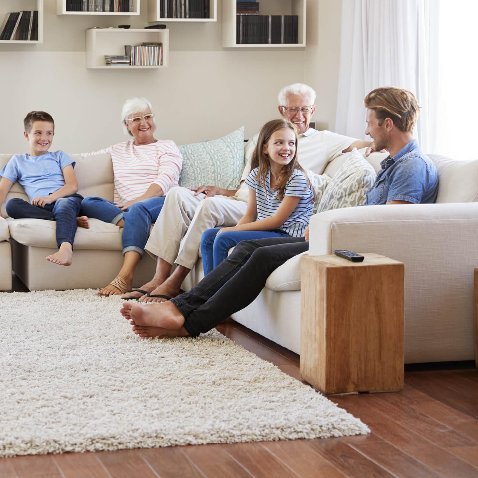 Family gosping in living room | Bassett Carpets